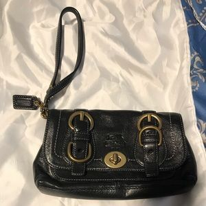 Coach wristlet with brass and Rainbow lining! CUTE